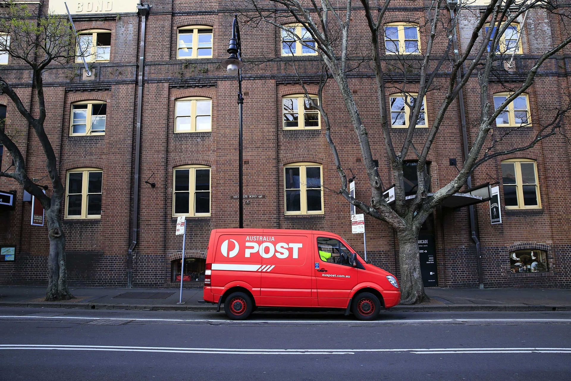 direct mail with Autralian Postal van outside building